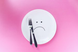 empty plate with frowning face